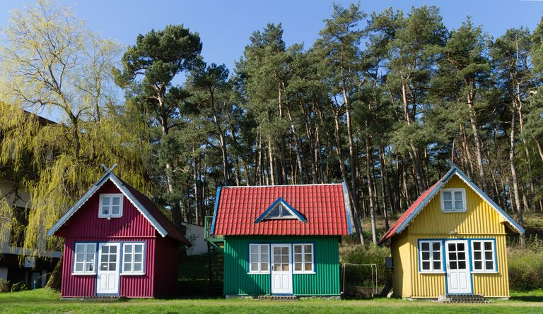 three colorful tiny homes
