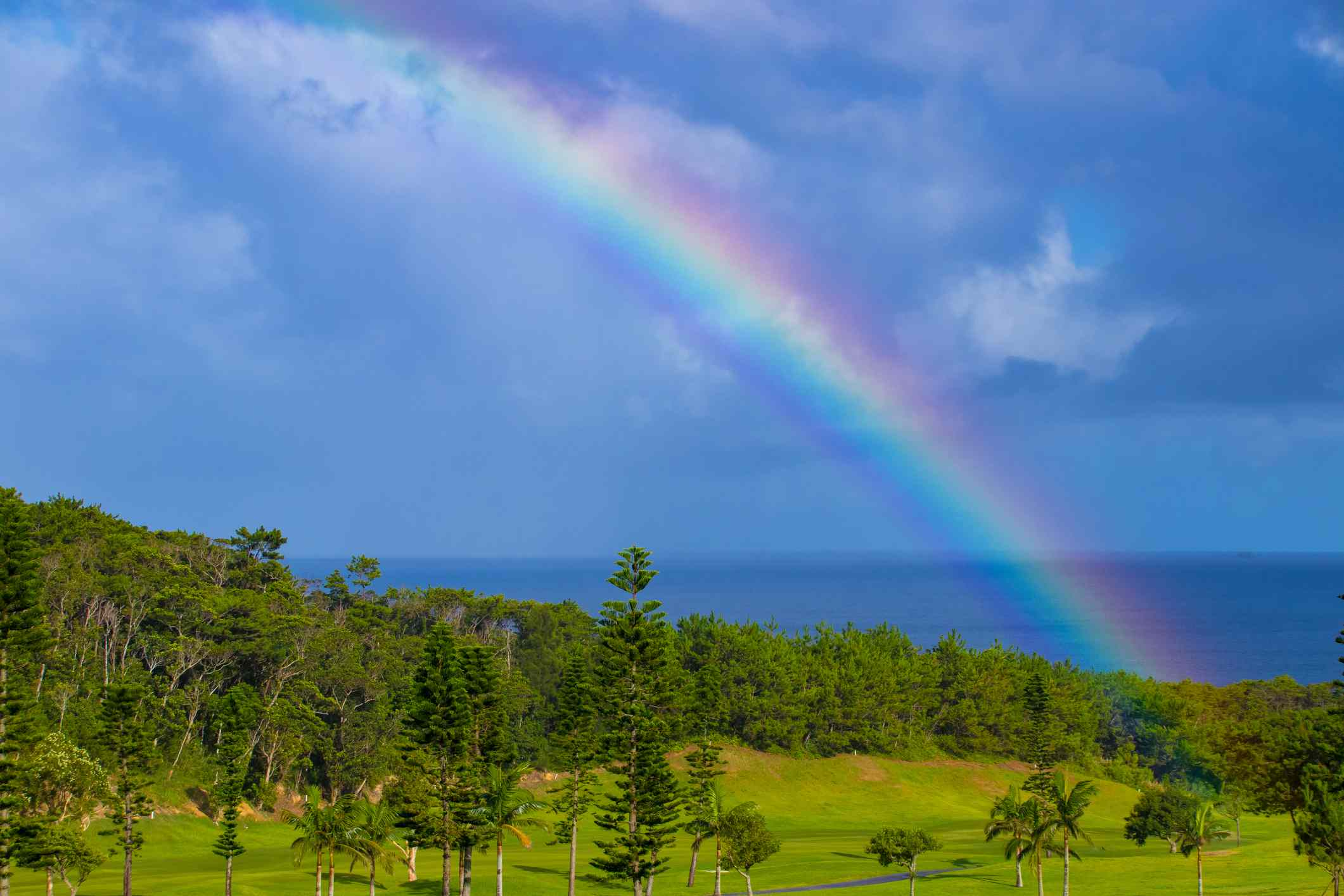 Rainbow over the mountain to the sea