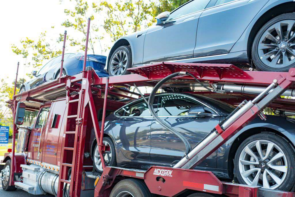Tesla vehicles being delivered to customers