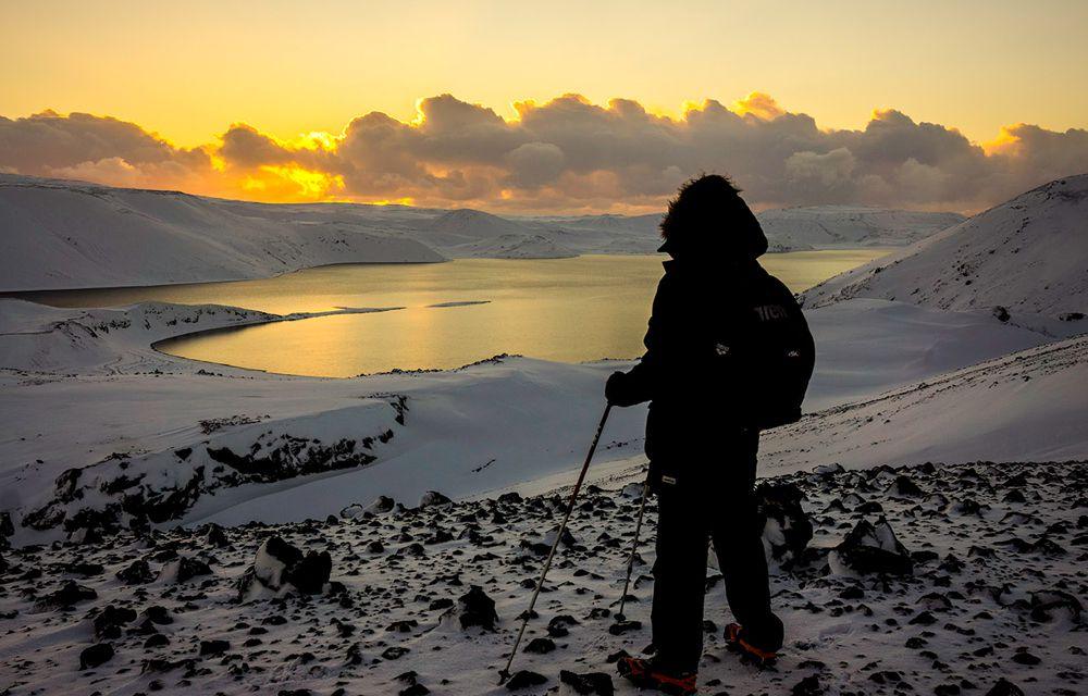 A hiker in Iceland observing the Winter Solstice in December 2014