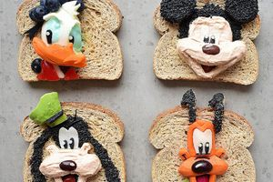 disney characters made from food on pieces of whole wheat bread