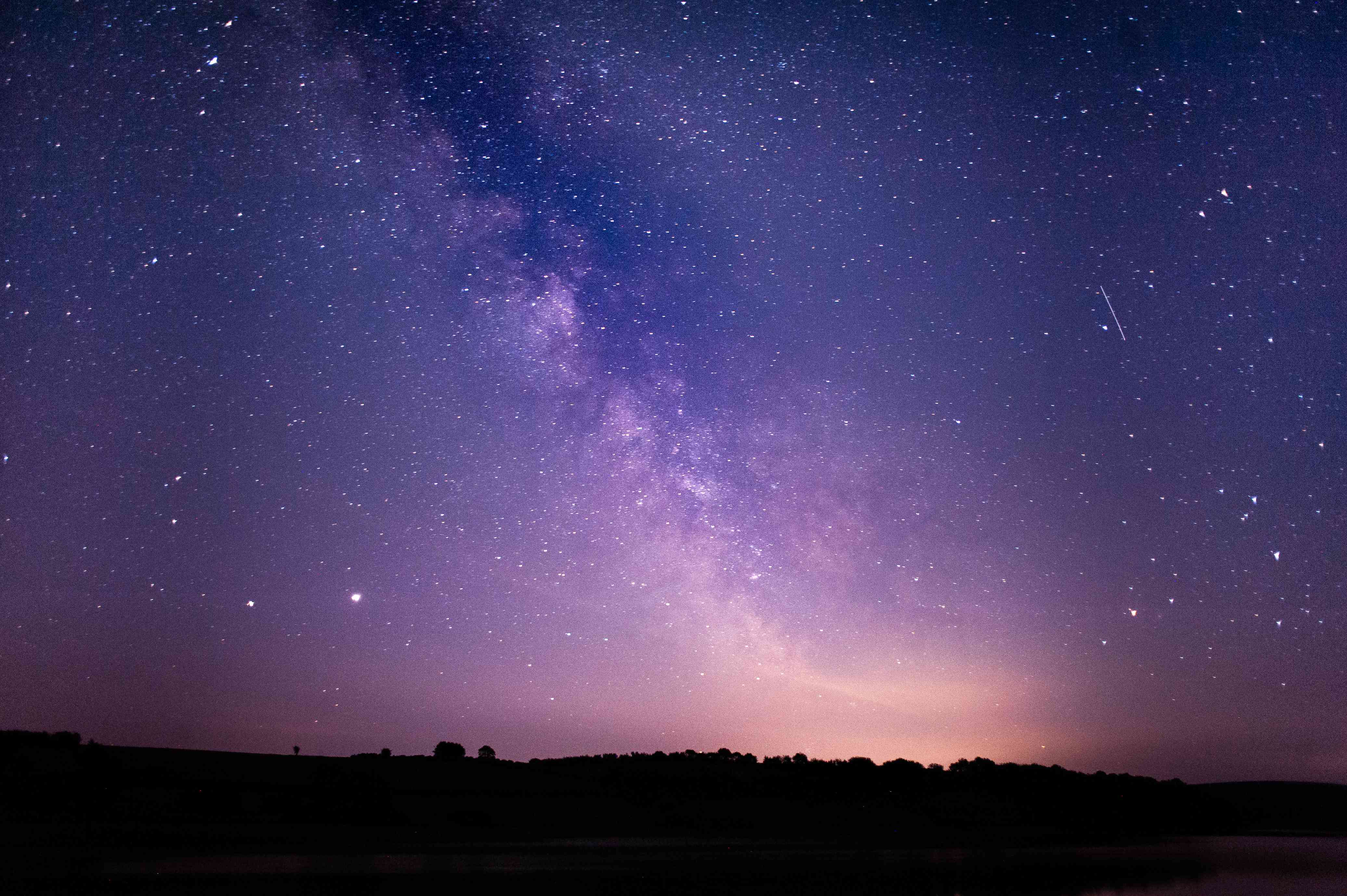 Colorful Milky Way over vast landscape of Exmoor National Park
