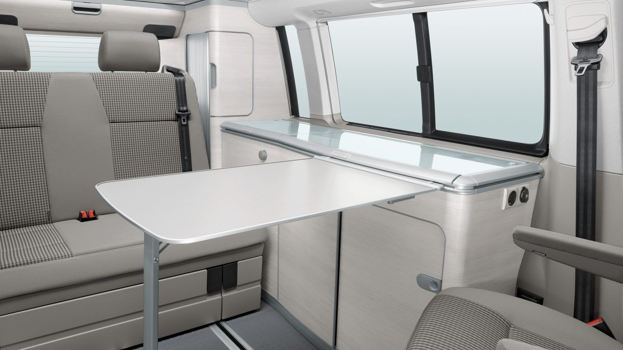 Interior table folded down in front of van seats
