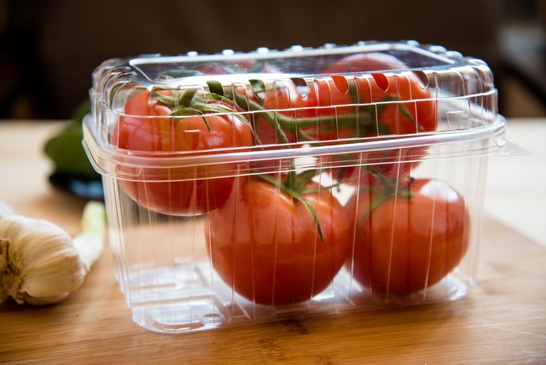 disposable plastic packaging container with tomatoes