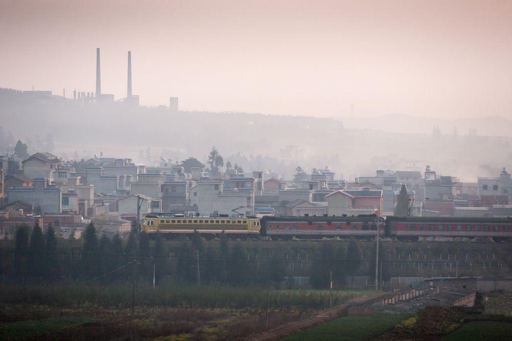 A train passes the old city of south Yunnan, China