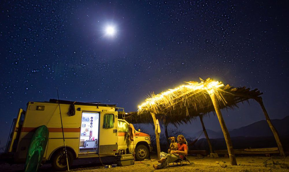 RV parked outside at night under a starry sky