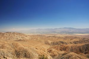 The San Andreas fault zone on a clear day with a deep blue sky