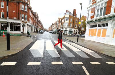 A woman seen crossing the UK's first '3D' zebra which has...