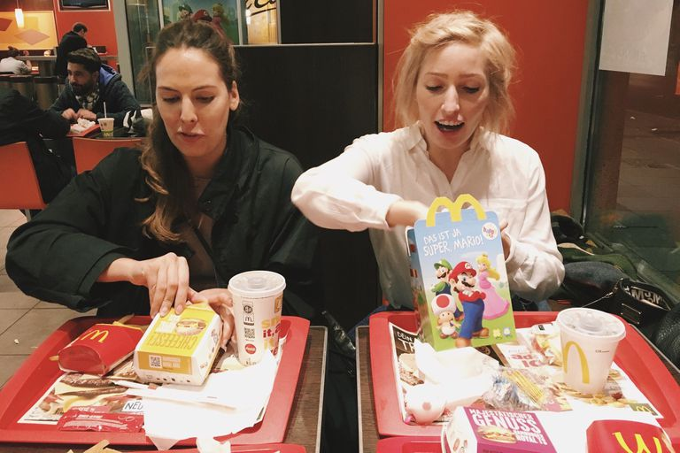 Two women eat at McDonald's
