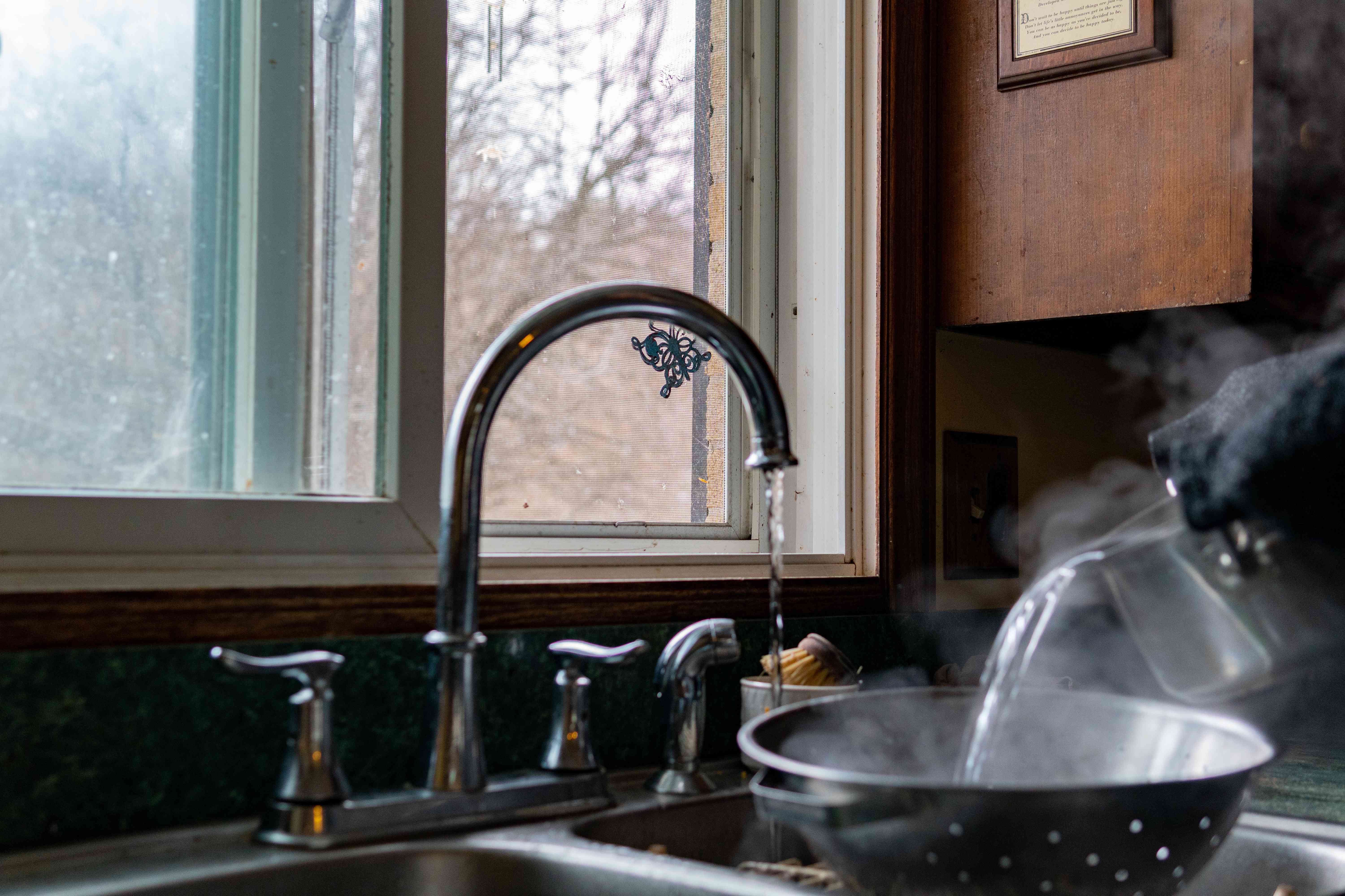 opened window while boiling water in kitchen