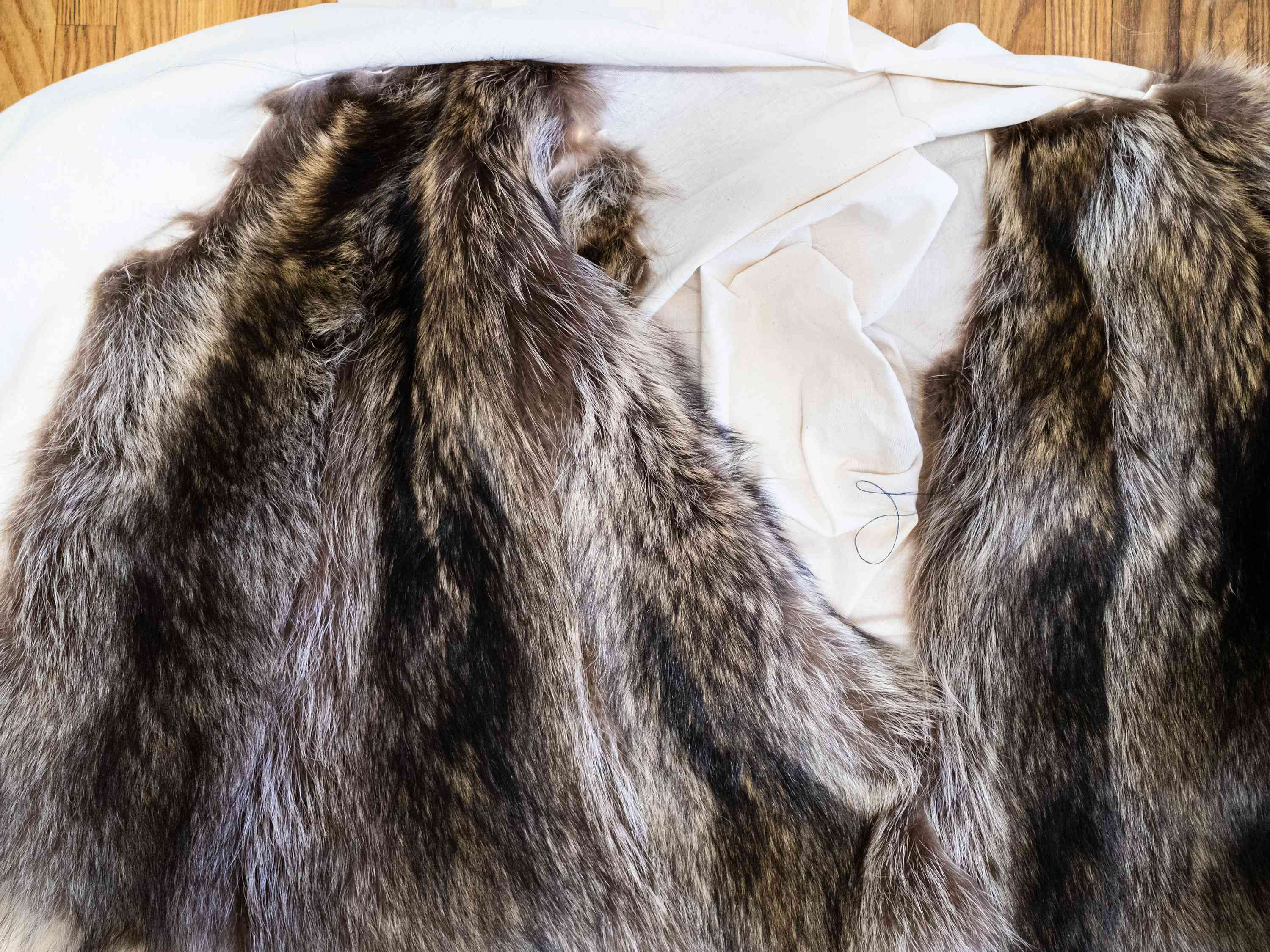 fur pelts on textile coat layout on table