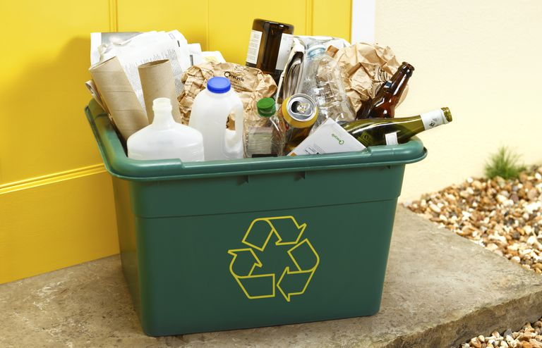 paper, glass, plastic and metal recycling in a recycling bin
