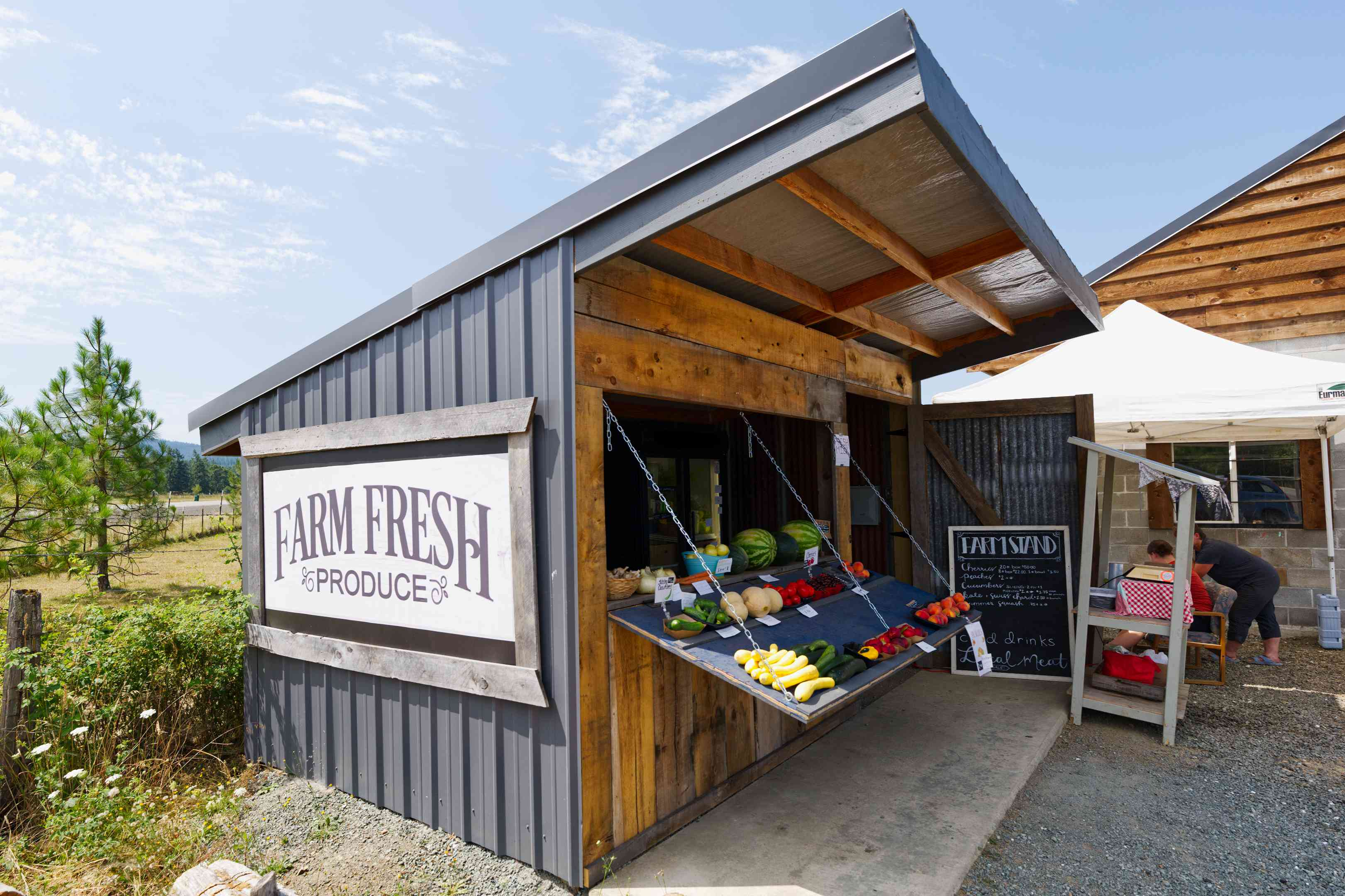 Small wooden store with large display of farm fresh produce