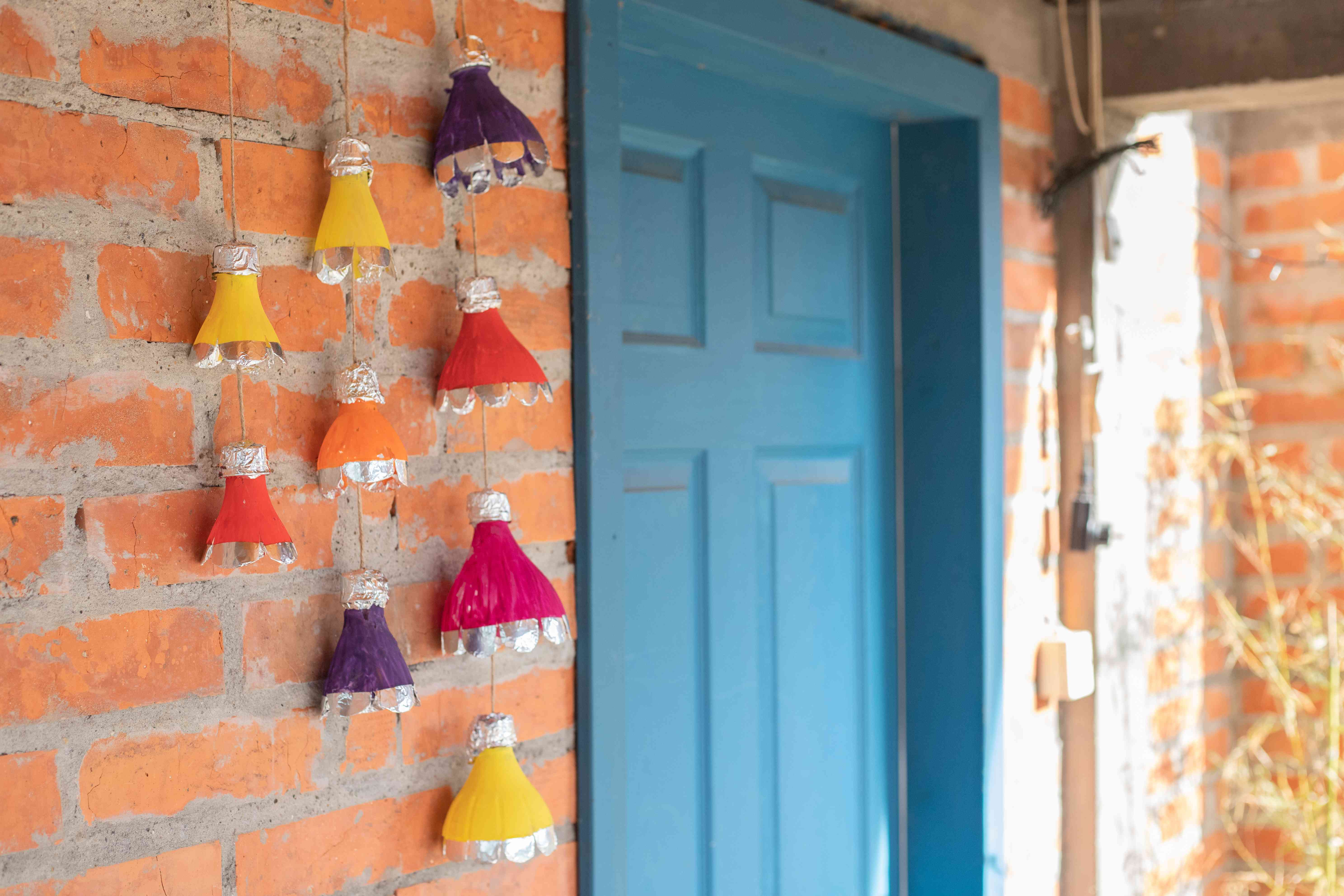 brightly colored plastic bottles upcycled into outdoor mobile