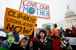 Activists hold signs as they participate in the Power Shift '09 rally on the West Lawn of the U.S. Capitol March 2, 2009 in Washington, DC. Youth activists called for urgent congressional actions on climate change, energy and the economy.