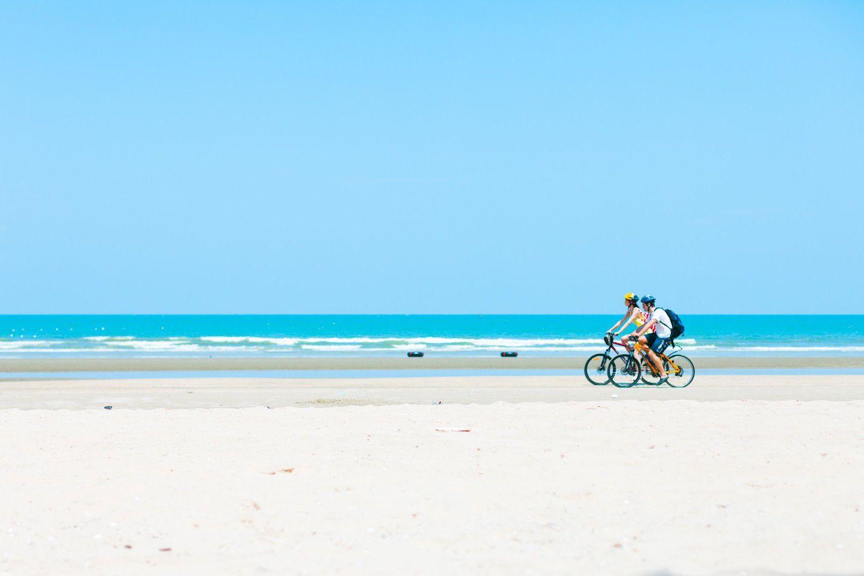 cycling along a beach
