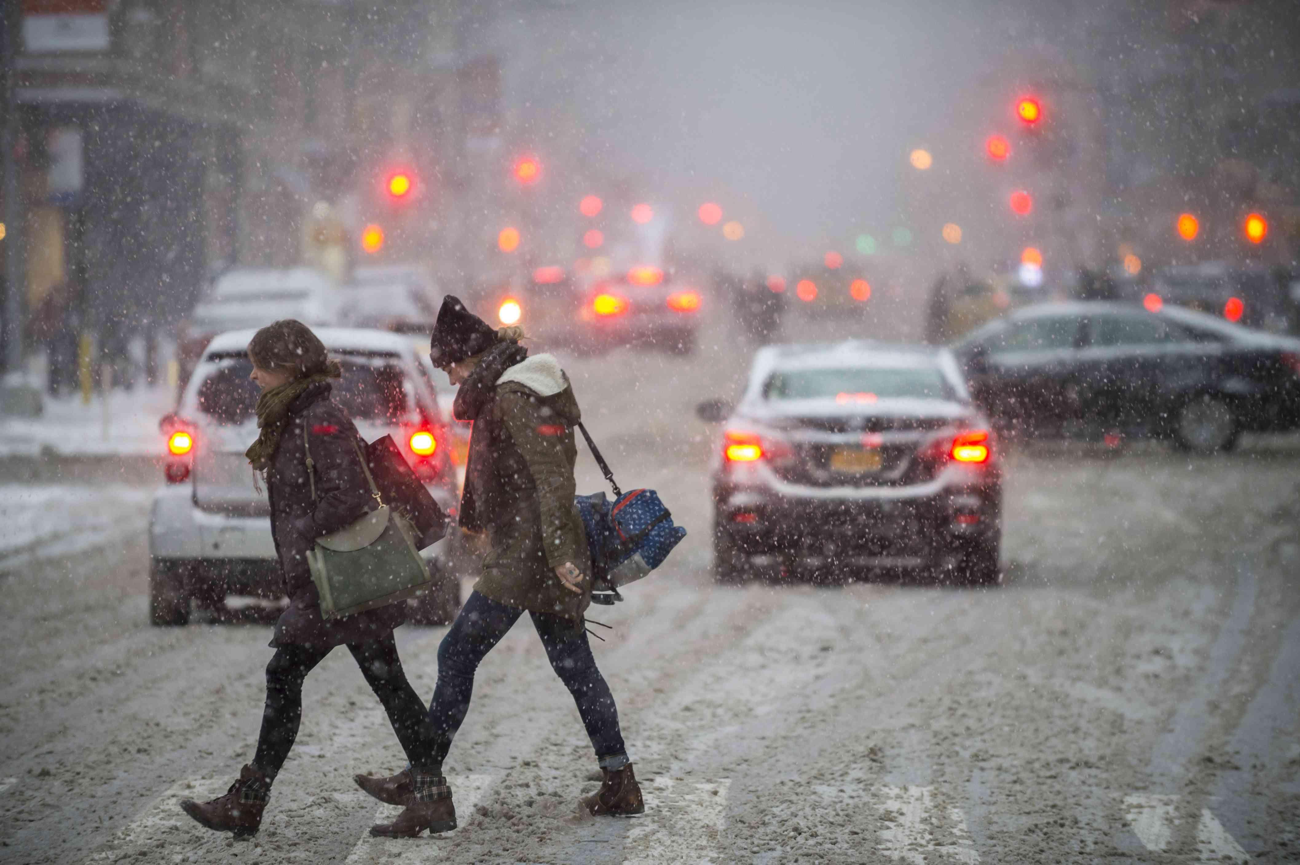 women walking in snow in NYC
