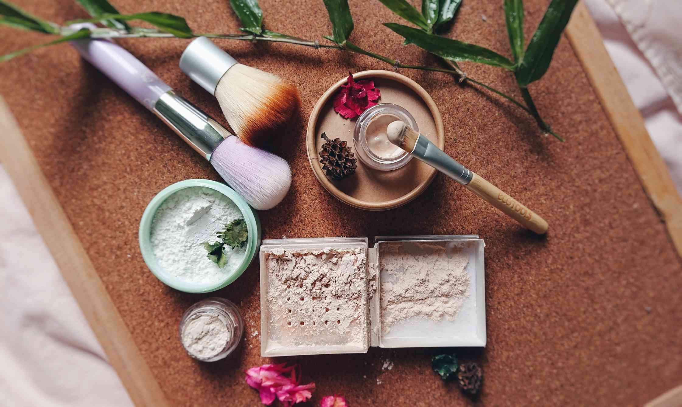 Flat lay of make-up brushes and mineral cosmetics on a towel.