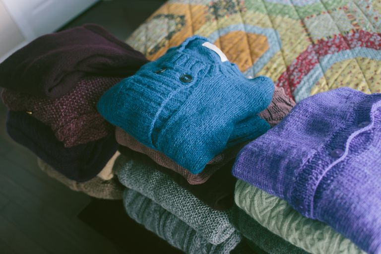 Wool sweaters folded neatly on top of one another.