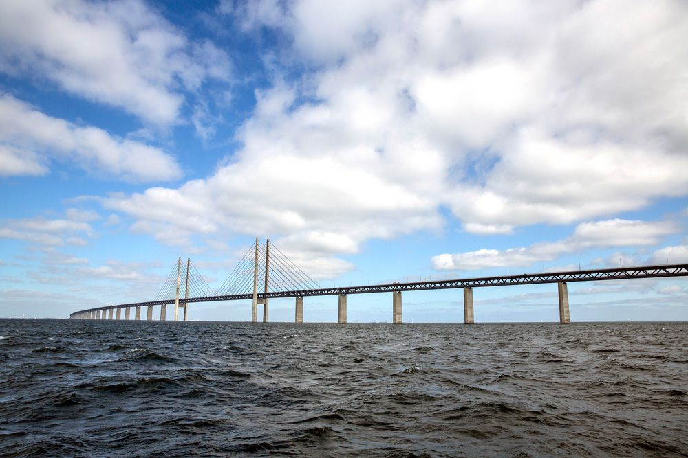 Øresund Bridge over choppy waters on a partly cloudy afternoon