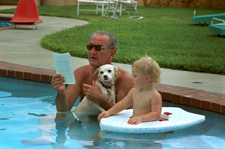 LBJ in a pool with his dog and grandson