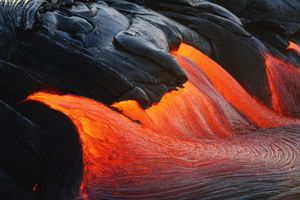 Streams of lava pouring during eruption of Kilauea volcano, Hawaii