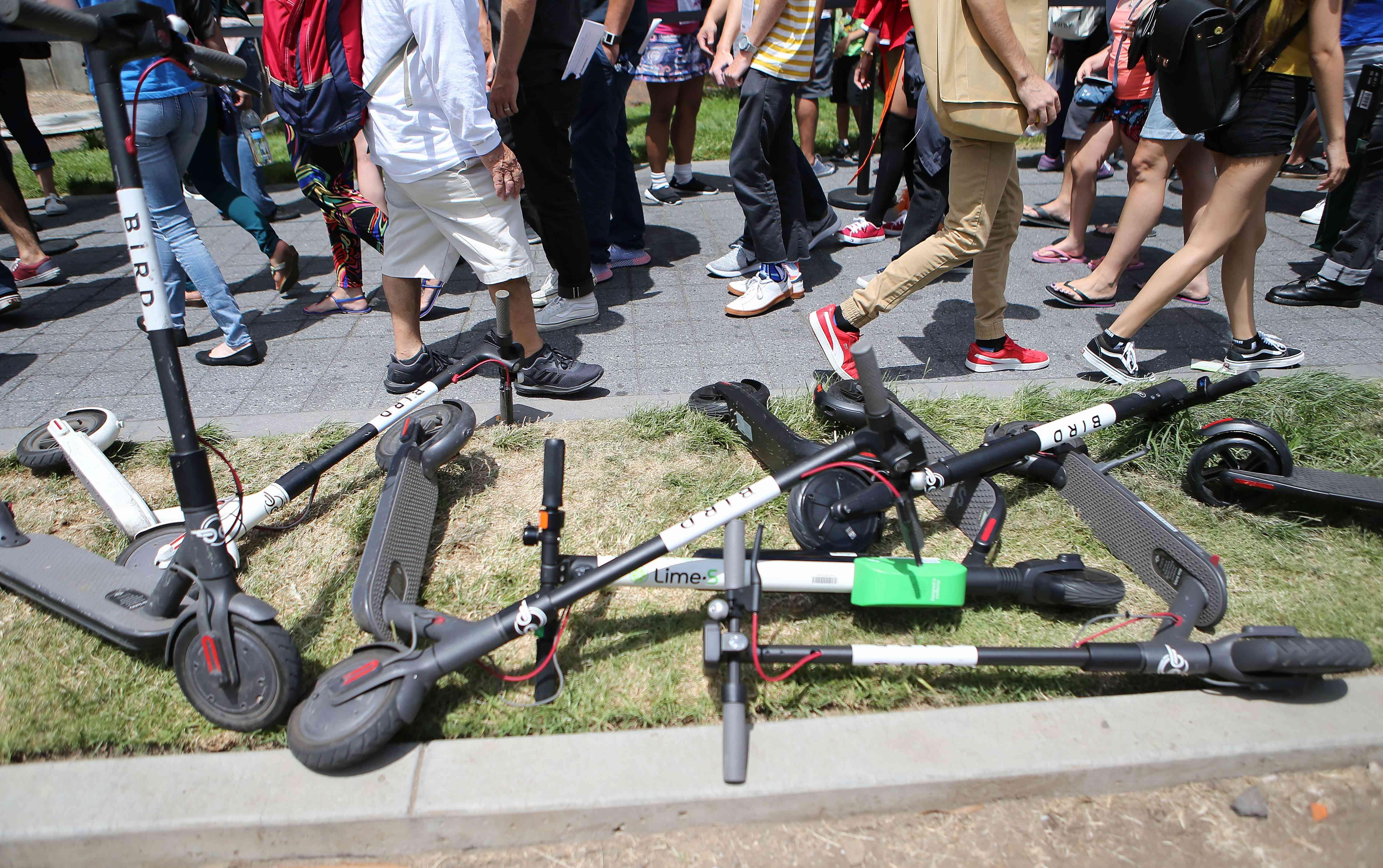 E-scooters litter sidewalk in San Diego