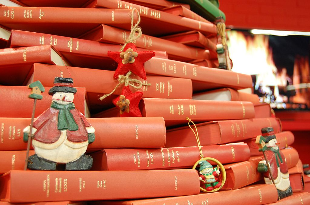 ornaments on christmas tree made of books