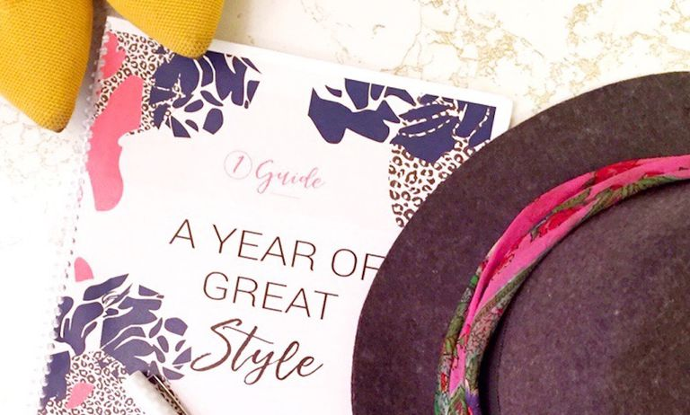 A year of great style pamphlet lays under a hat