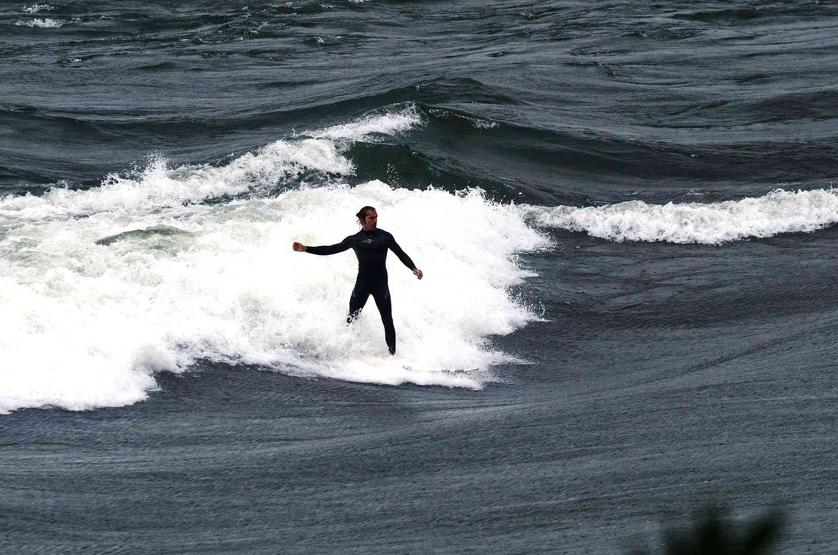 Aerial view of. a surfer on the Habitat 67 wave on the Saint Lawrence River in Montreal