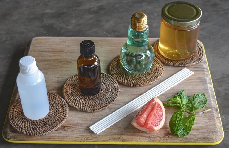 wooden cutting board with various diffuser ingredients