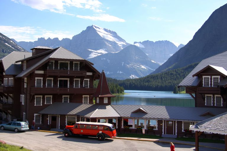 A hotel on a lake with mountains in the background
