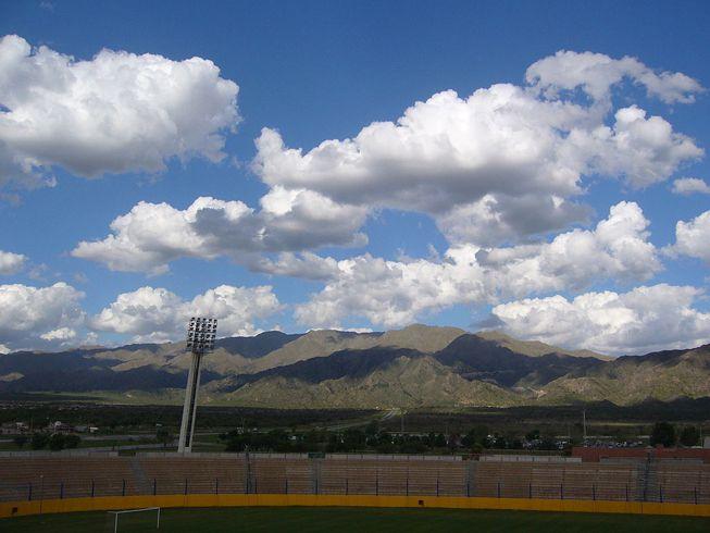 Cumulus mediocris clouds over a sports field