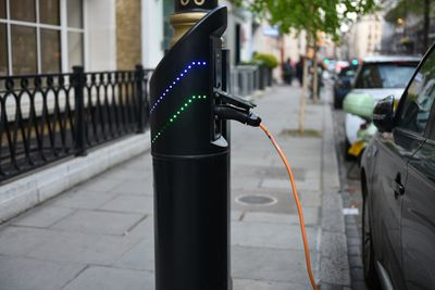 Electric car charging point, London, UK