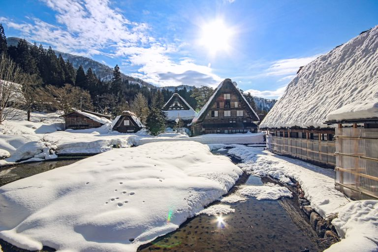 Snowy small town under a bright sun