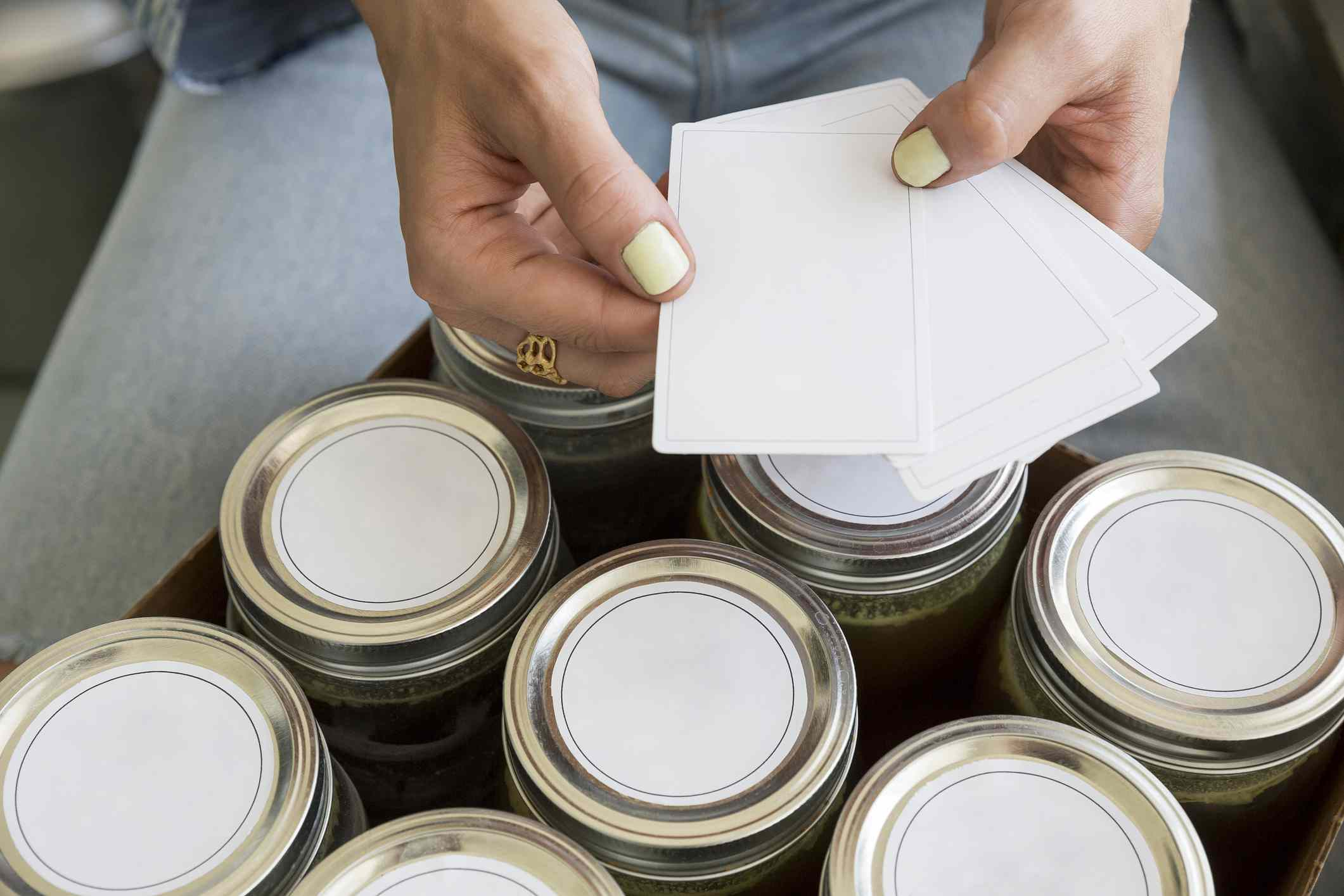 Woman with blank labels for mason jars
