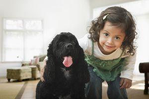 Hispanic girl hugging dog