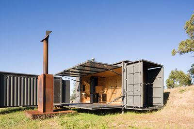shipping container cottage opened up
