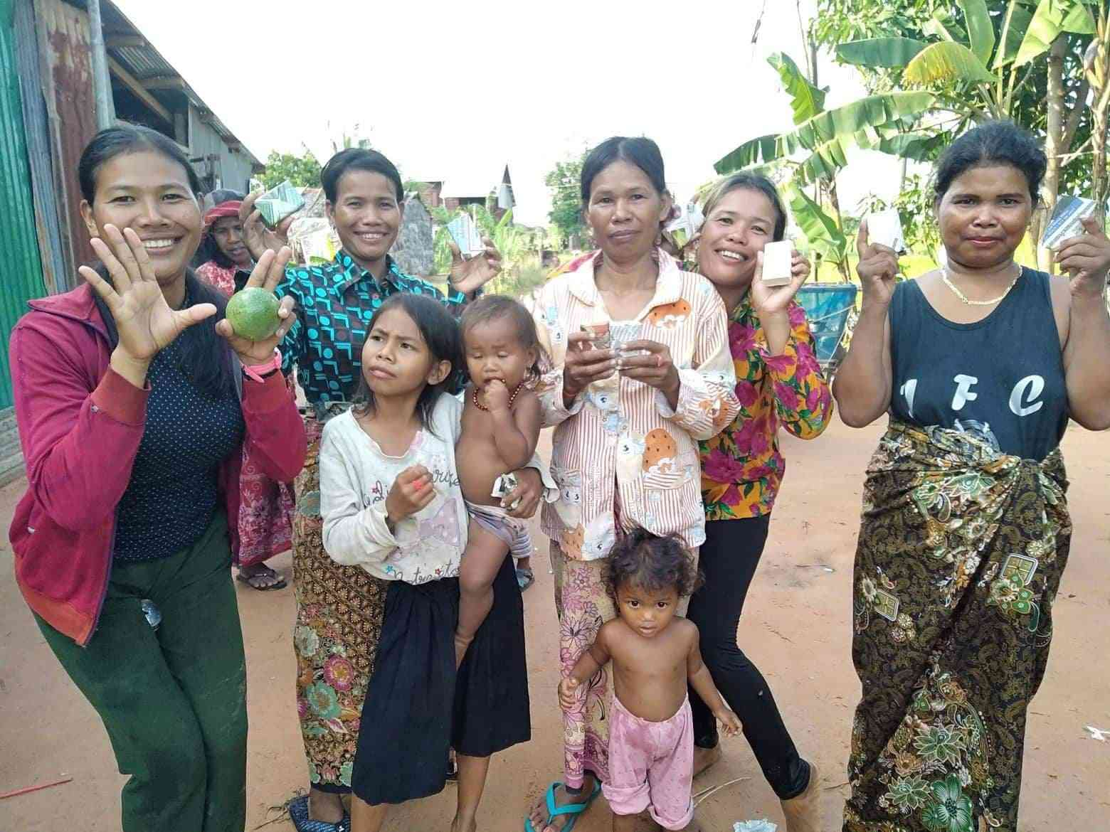 Women and children pose with new donated soap in Cambodia