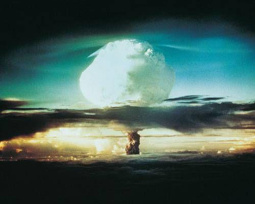 Mushroom cloud exploding over a landscape