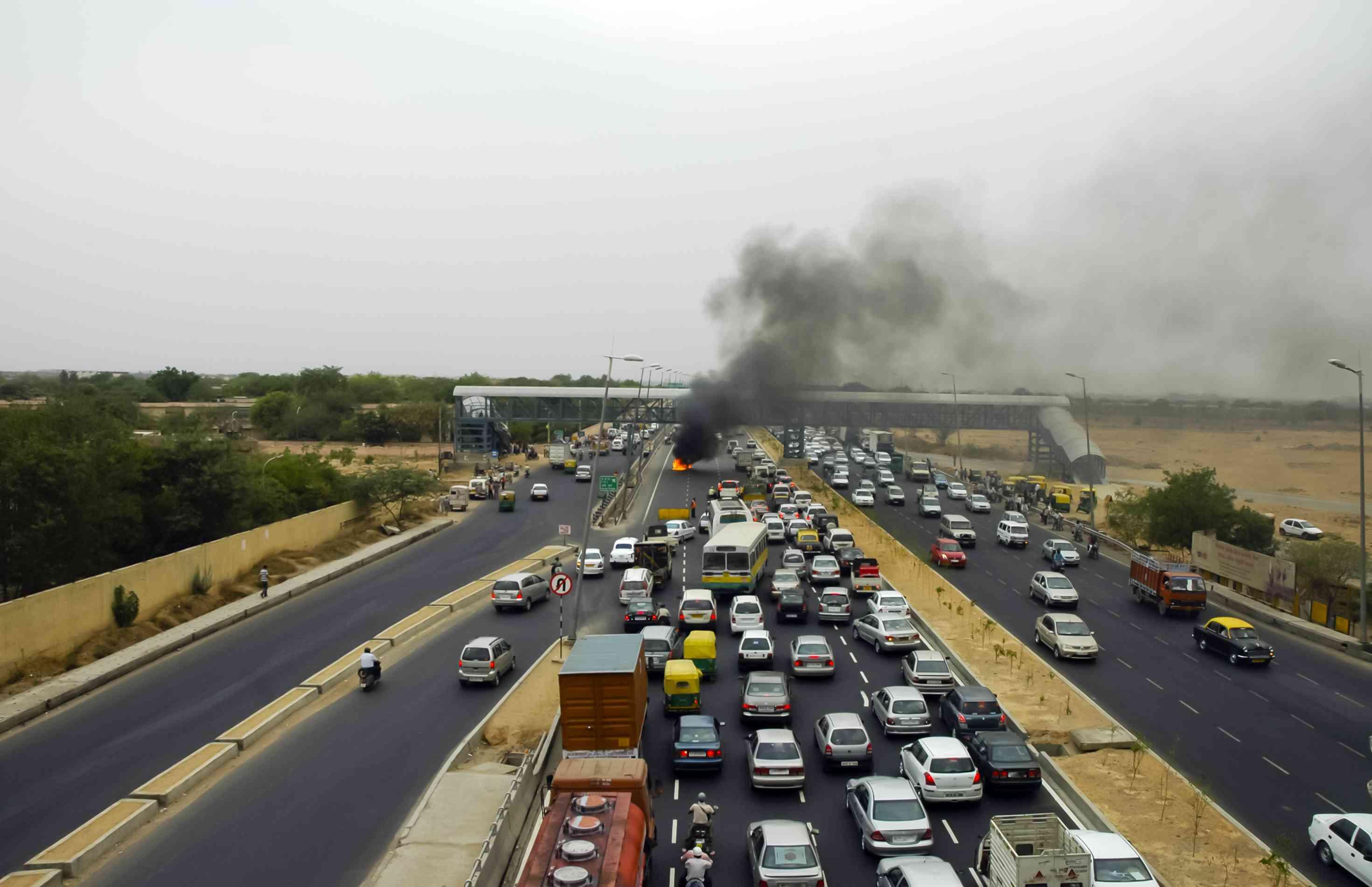 A car fire disrupting traffic in India