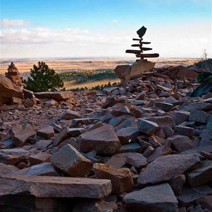 Stone balancing in rocky field