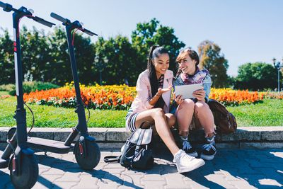 Tourists renting scooters to explore new city