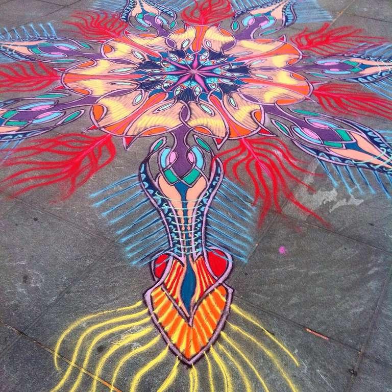 Mandala sand art on city sidewalk