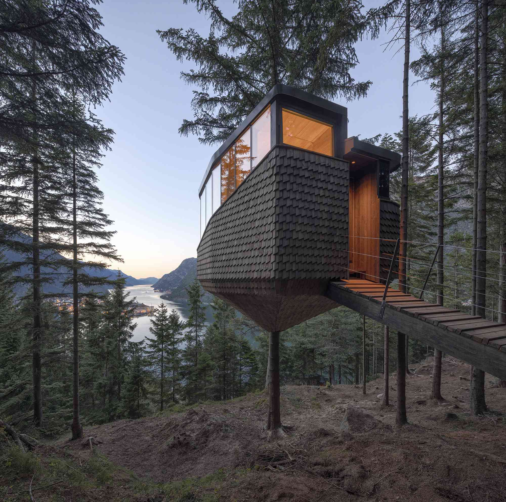 Woodnest treehouse cabin by Helen & Hard Architects exterior and view of entry bridge