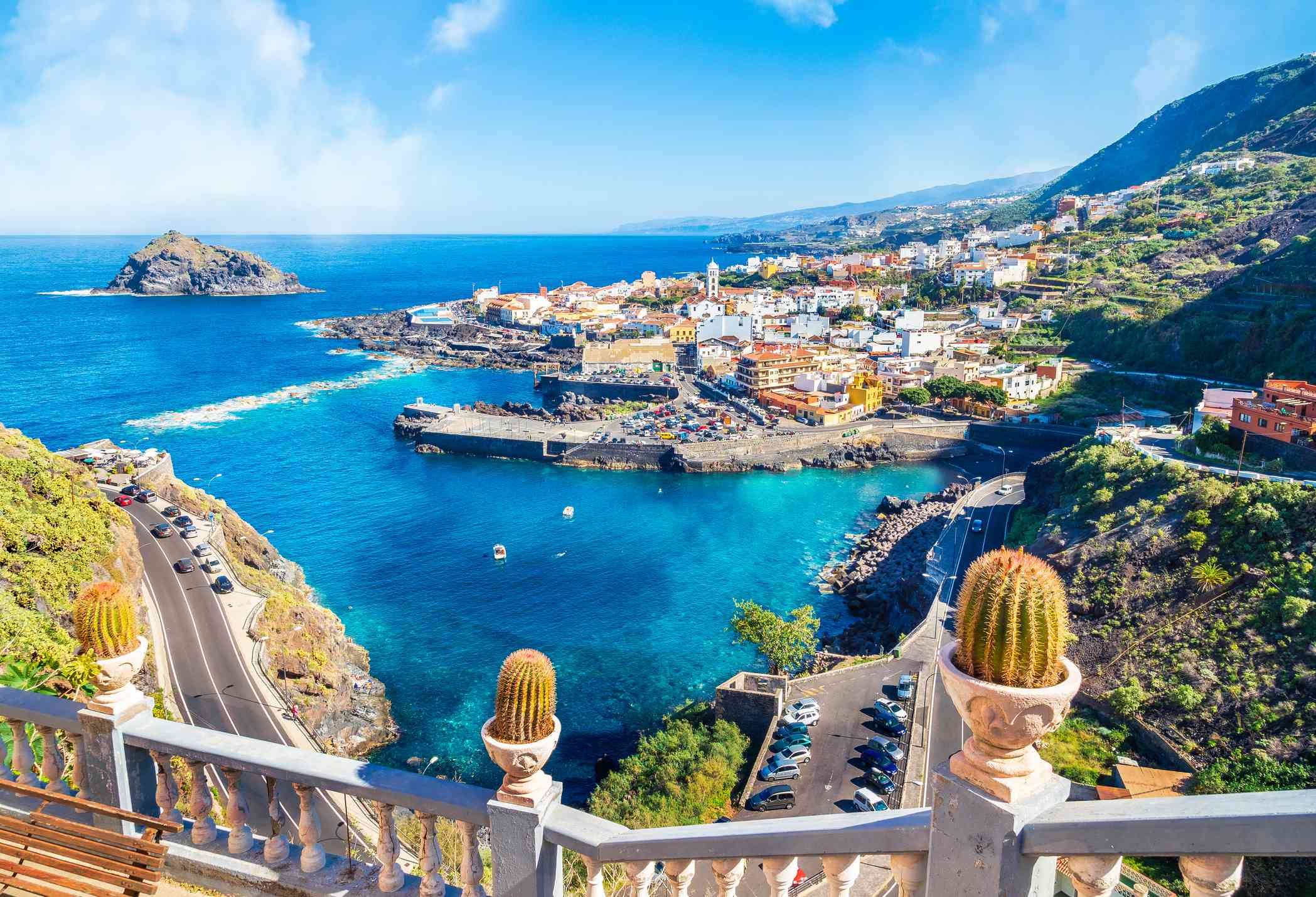 landscape of Canary Islands with blue water and cityscape with colorful buildings