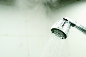 Steaming water flowing from a shower faucet