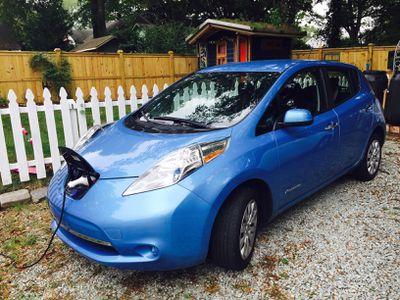 Nissan leaf charging in a driveway