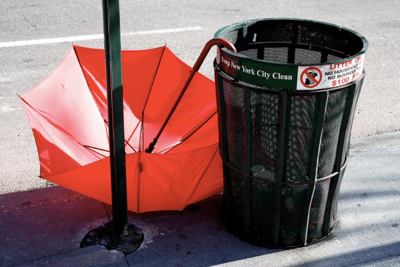 Classic NYC public litter bin with umbrella