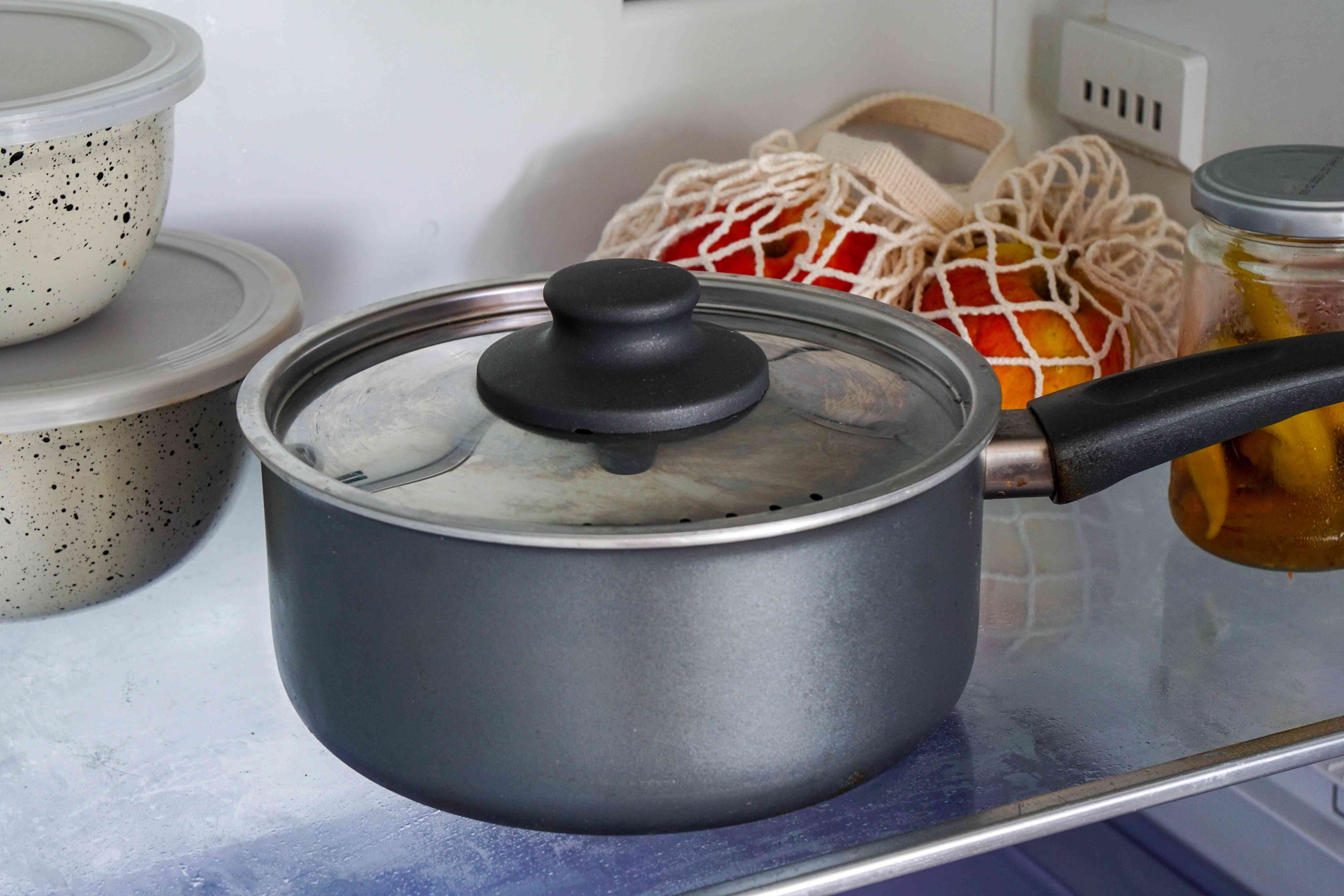 cooking pot with lid is stored inside fridge to cut down on plastic use
